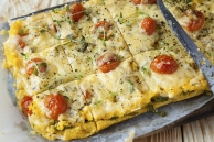Baked Polenta With Sun Dried Tomatoes, Cheese, and Herbs